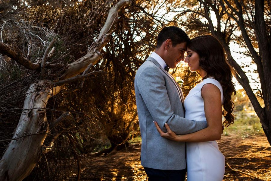wedding photography perth rottnest island wedding image of bride and groom hugging