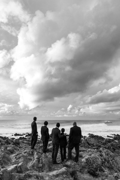 wedding photography perth image of groomsmen standing on rocks in yallingup