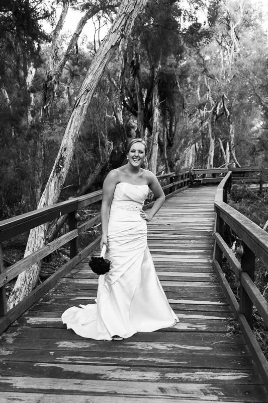 perth wedding photographer south perth wedding image of bride laughing on board walk