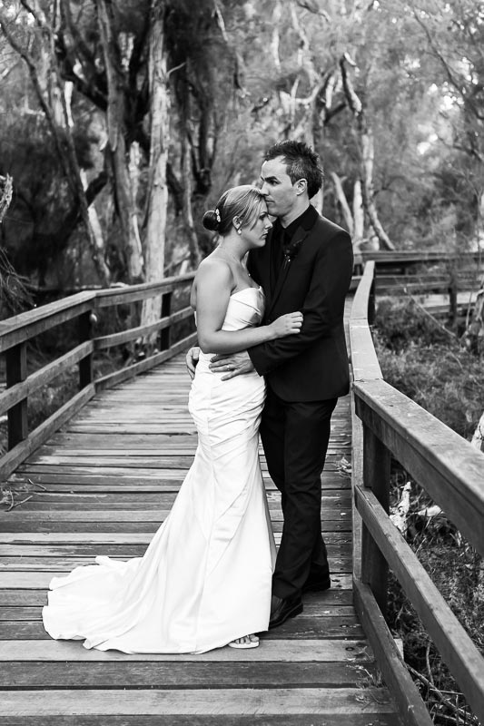 perth wedding photographer south perth wedding image of bride and groom standing on jetty