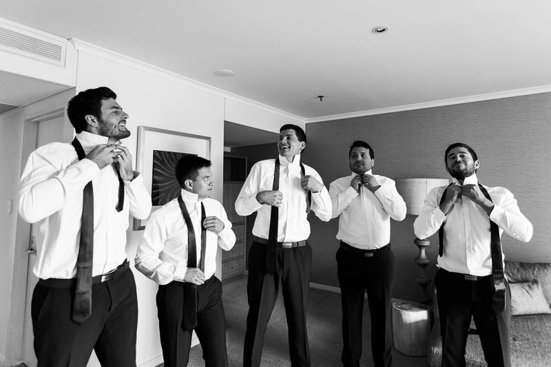 wedding photographer perth matilda bay wedding image of groom and groomsmen putting on ties
