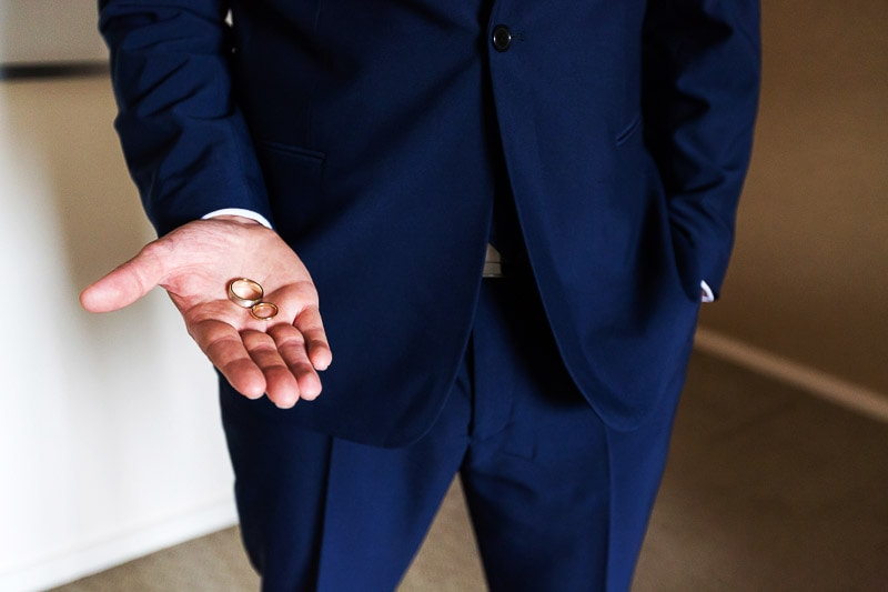 wedding photographer perth matilda bay wedding image of groom holding rings