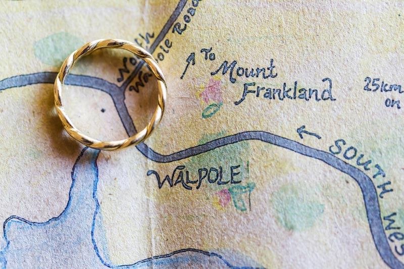 south west wedding photographer image of map of walpole with wedding ring on it