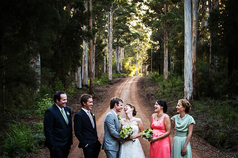 south west wedding photographer image of bridal party laughing on dirt road
