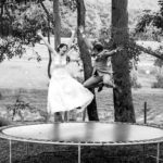 top australian wedding blogs wedding planning perth image of bride and groom jumping on trampoline
