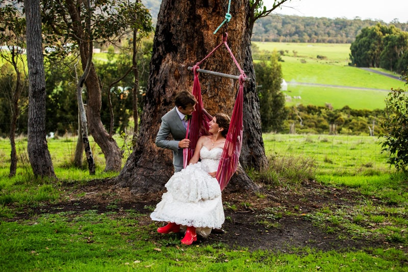 south west wedding photographer image of bride and groom on swing