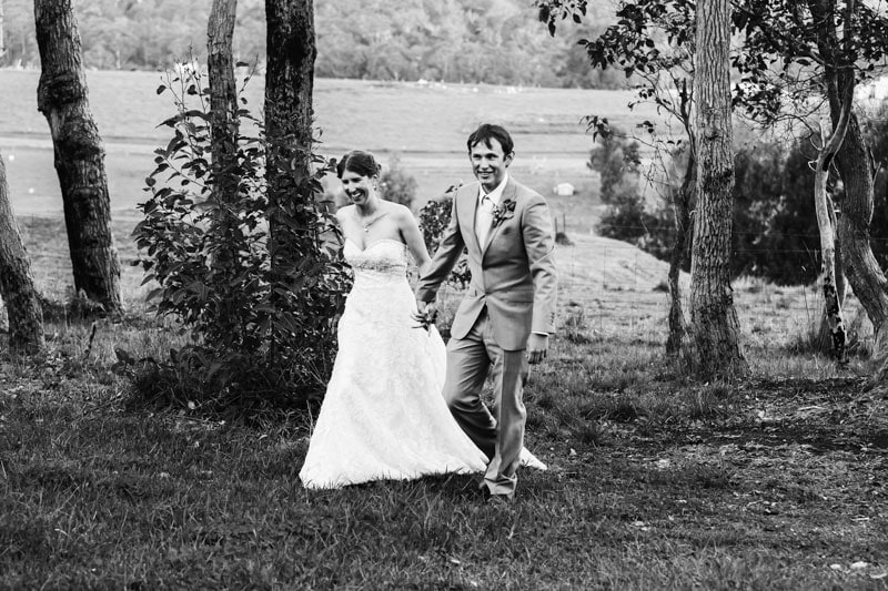 south west wedding photographer image of bride and groom walking