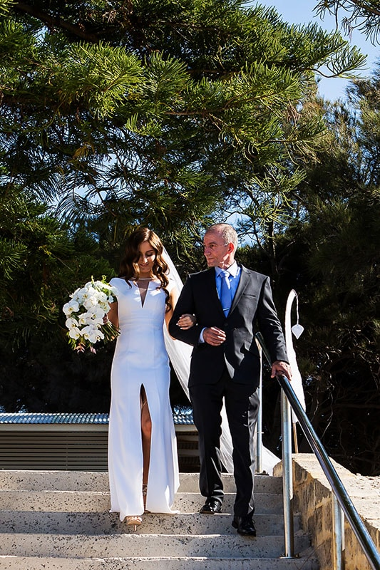 perth wedding photographer rottnest island wedding image of bride and father walking down steps