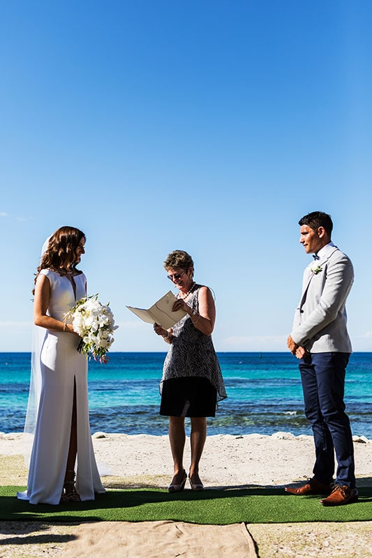 perth wedding photographer rottnest island wedding image of bride and groom at ceremony on the beach