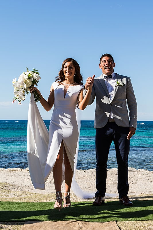 perth wedding photographer rottnest island wedding image of bride and groom happy and laughing at ceremony