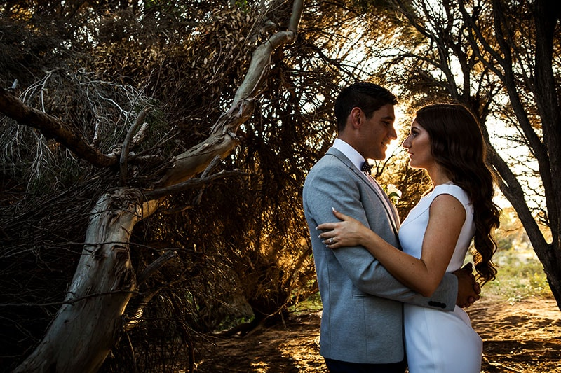 perth wedding photographer rottnest island wedding image of bride and groom looking at each other in golden light