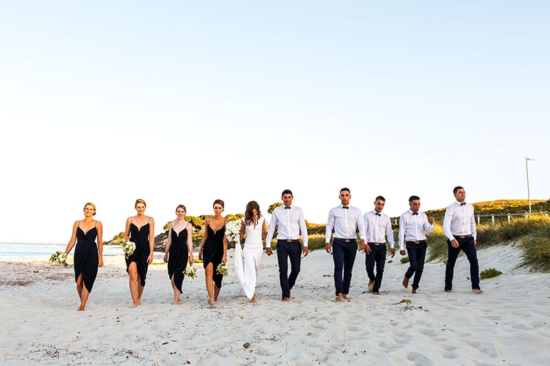 perth wedding photographer rottnest island wedding image of bridal party walking on beach on rottnest island