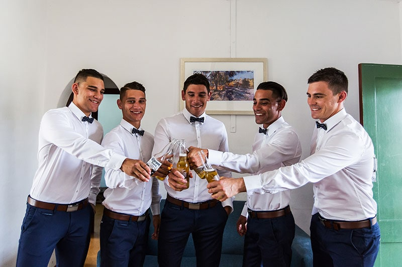 perth wedding photographer rottnest island wedding image of groom and groomsmen with beers