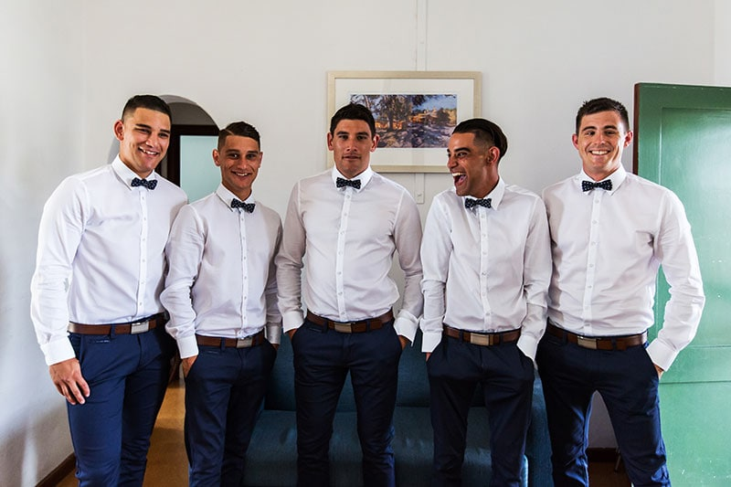 perth wedding photographer rottnest island wedding image of groom and groomsmen laughing