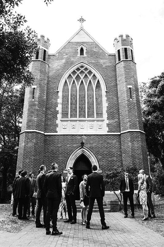perth wedding photographer perth wedding image of guests waiting outside church