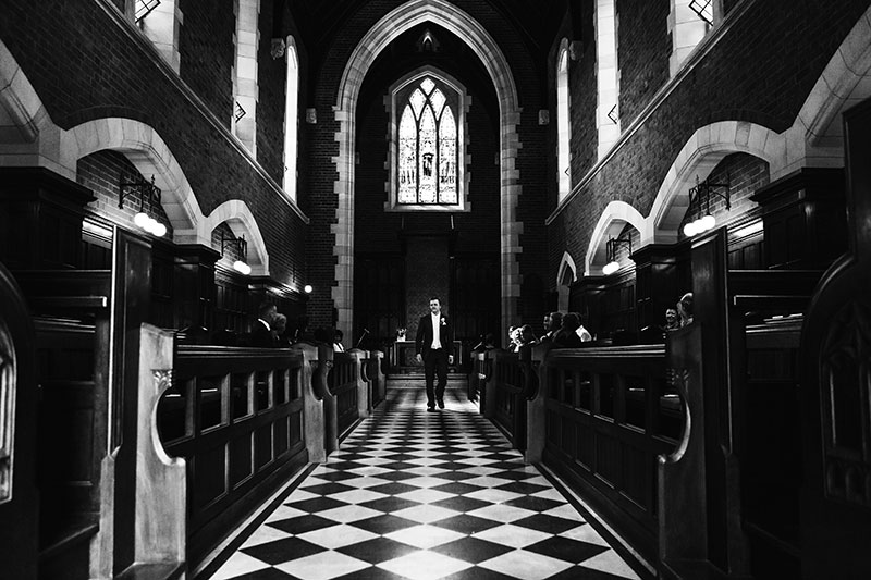 perth wedding photographer perth wedding image of groom walking in church