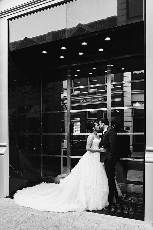 perth wedding photography perth city wedding image of bride and groom kissing