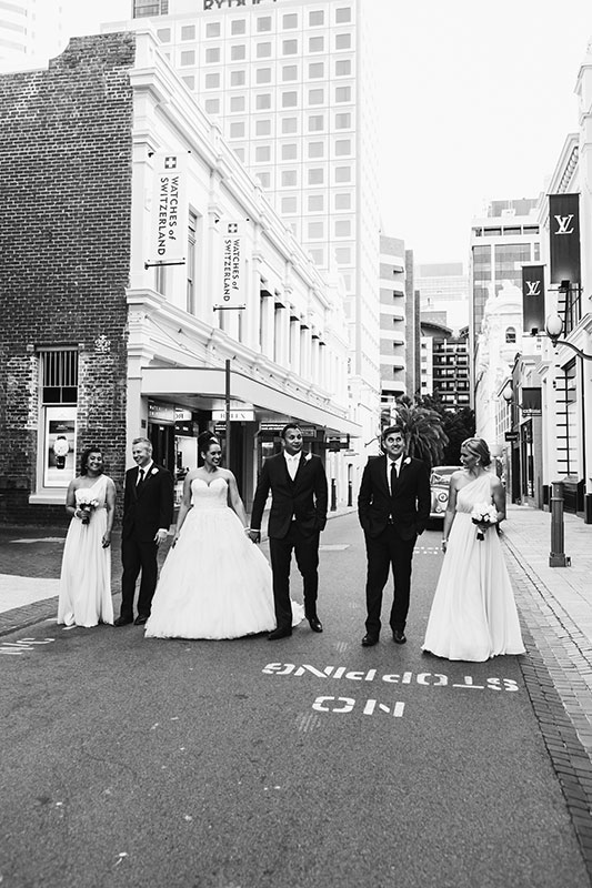 perth wedding photography perth city wedding image of bridal party walking down city street