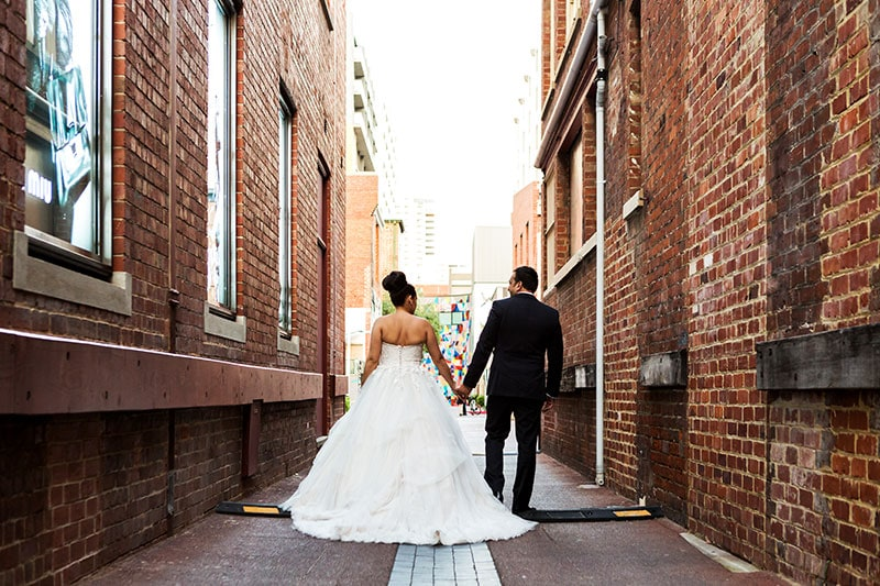 perth wedding photography perth city wedding image of bride and groom walking in city