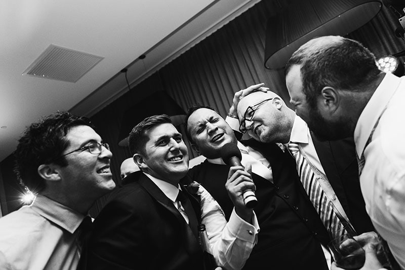 perth wedding photography perth city wedding image of guests singing at receptio