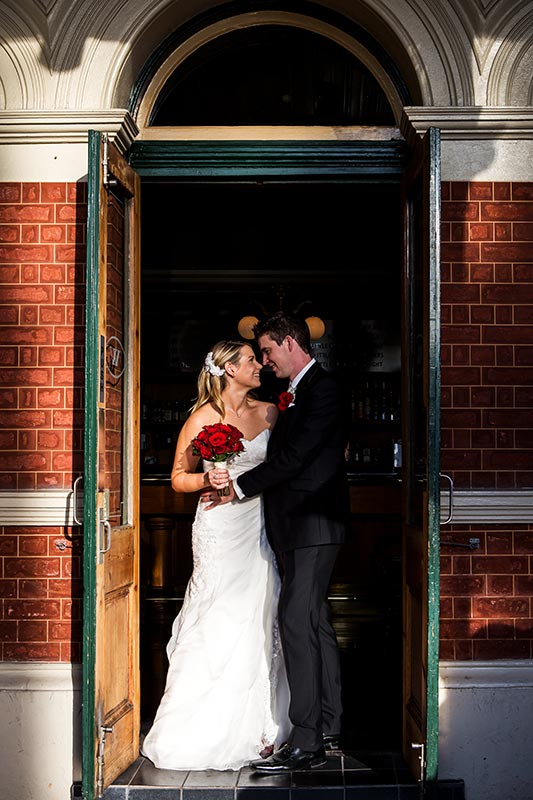 wedding photographer perth kings park wedding image of bride and groom standing in door way