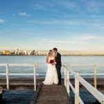 wedding photographer perth perth wedding image of bride and groom on jetty at sunset