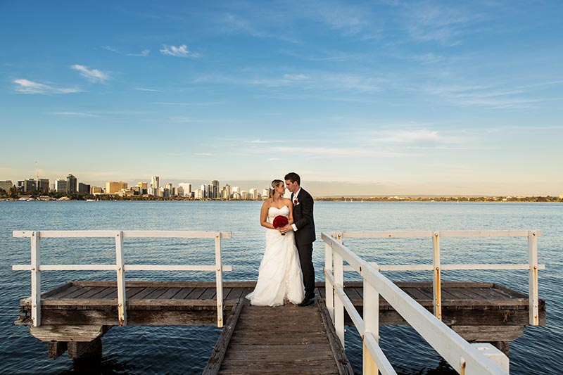wedding photographer perth kings park wedding image of bride and groom on jetty at sunset