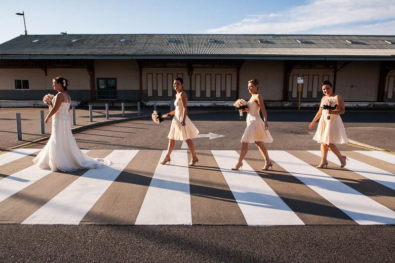 fremantle wedding photographer fremantle wedding perth wedding photographer image of bride and bridesmaids walking across cross walk