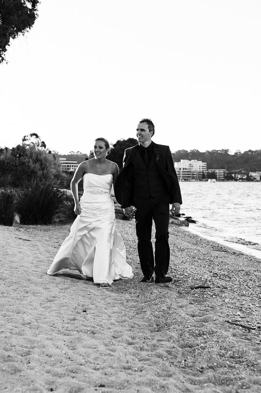 perth wedding photographer south perth wedding image of bride and groom walking along river bank