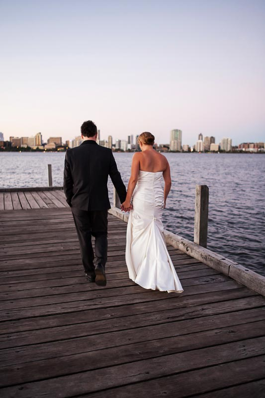 perth wedding photographer south perth wedding image of bride and groom walking along jetty