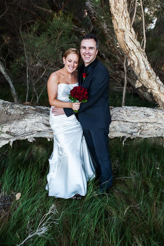 perth wedding photographer south perth wedding image of bride and groom hugging and laughing