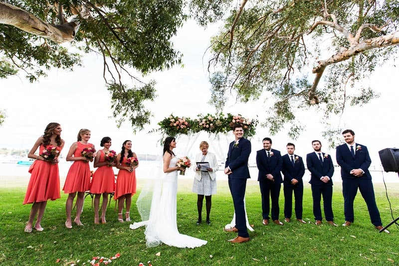 wedding photographer perth matilda bay wedding image of bridal party and celebrant at ceremony under tree