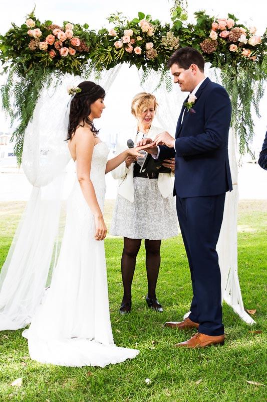 wedding photographer perth matilda bay wedding image of groom putting ring on bride's finger