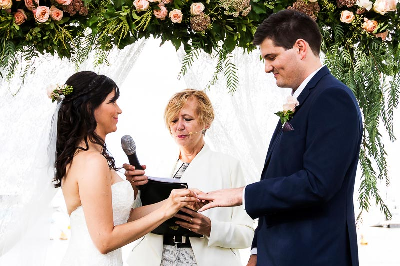wedding photographer perth matilda bay wedding image of bride putting ring on groom's finger