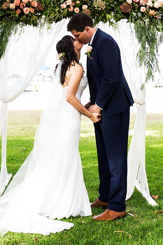 wedding photographer perth matilda bay wedding image of bride and groom first kiss at ceremony