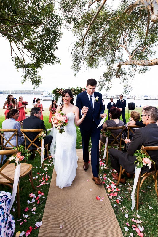 wedding photographer perth matilda bay wedding image of bride and groom walking down isle after being married