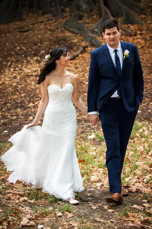 wedding photographer perth matilda bay wedding image of bride and groom walking away from tree