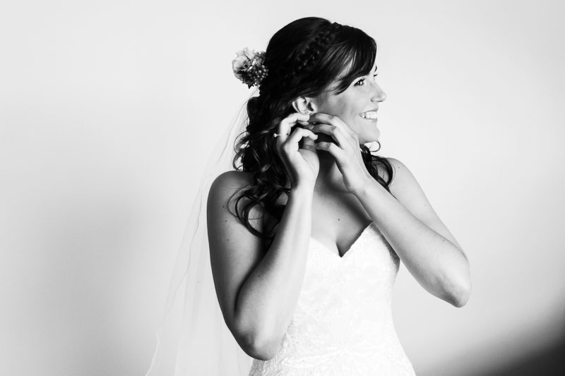 wedding photographer perth matilda bay wedding image of bride putting on earings