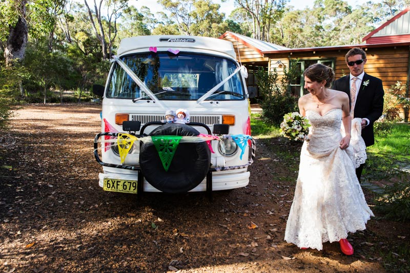 south west wedding photographer image of bride seeing decorated kombi van for first time