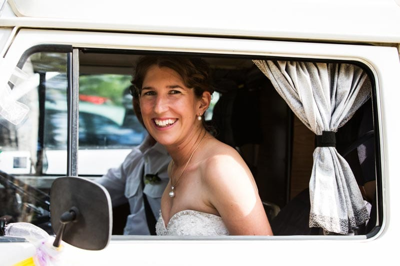 south west wedding photographer image of bride through kombi window