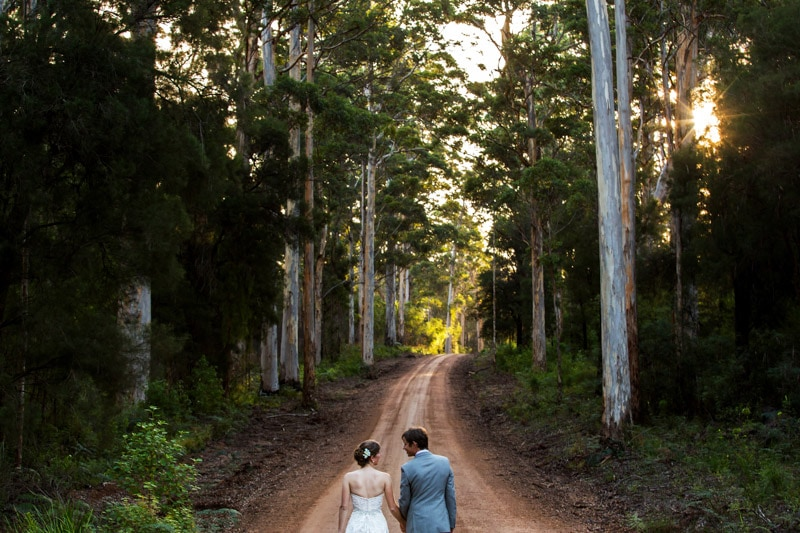 south west wedding photographer image of bride and groom walking on dirt road