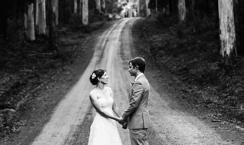 south west wedding photographer image of bride and groom holding hands on dirt road