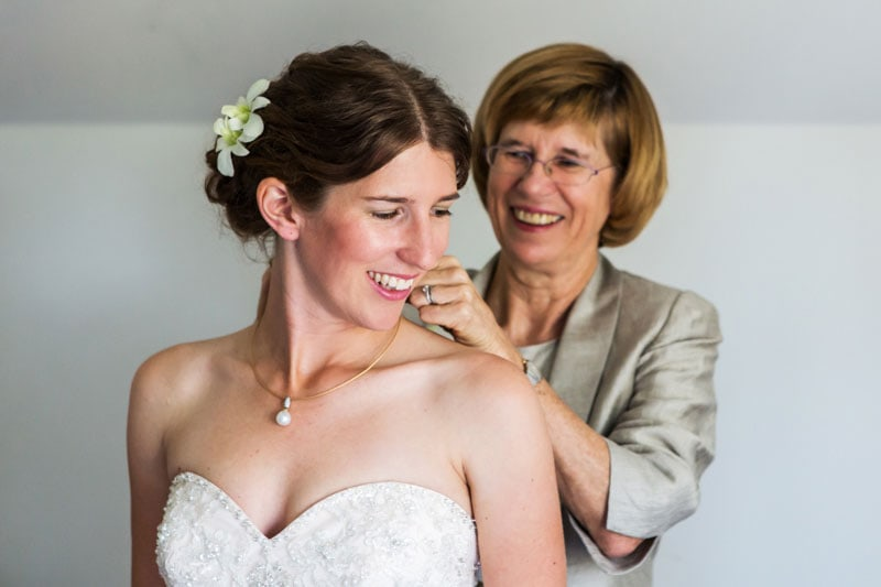 south west wedding photographer image of bride getting ready with mum