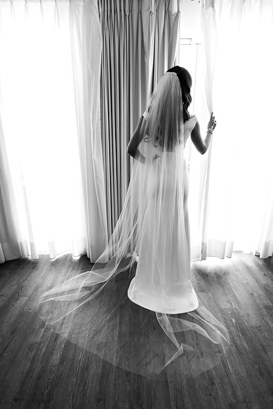 perth wedding photographer rottnest island wedding image of bride looking out window