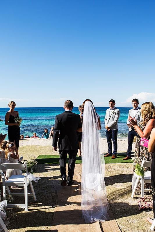 perth wedding photographer rottnest island wedding image of bride and father walking down isle