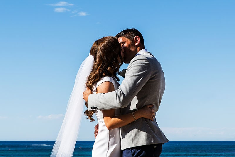 perth wedding photographer rottnest island wedding image of bride and groom ceremony kiss
