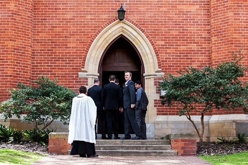 perth wedding photographer perth wedding image of groom outside church waiting for bride
