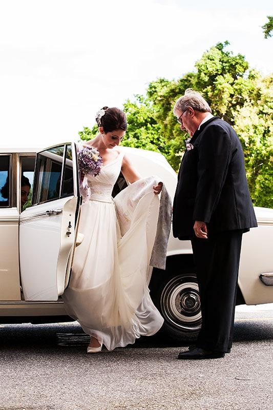 perth wedding photographer perth wedding image of bride's car arriving at church