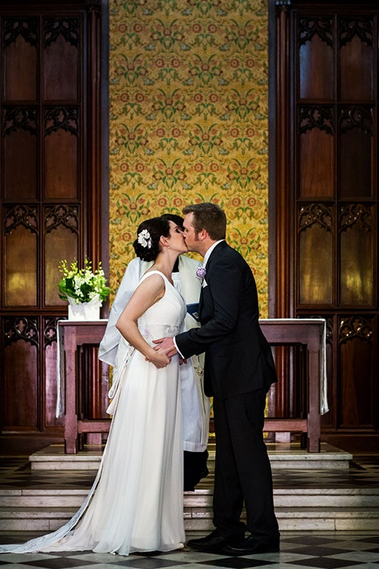 perth wedding photographer perth wedding image of bride and groom at church ceremony kissing
