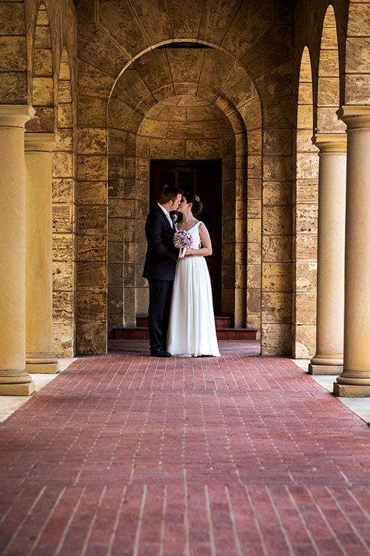 perth wedding photographer perth wedding image of bride and groom kissing at uwa